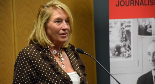 Image of Susan Fornoff accepting the Distinguished Terrapin award